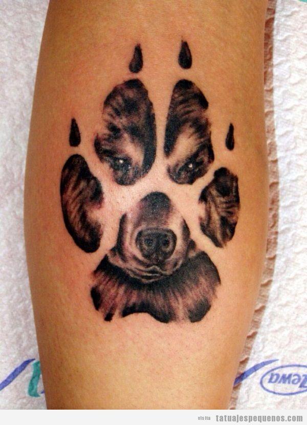 Tatuaje pequeño huella y cara de perro