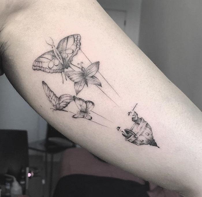 Tatuaje mariposas globo aerostático