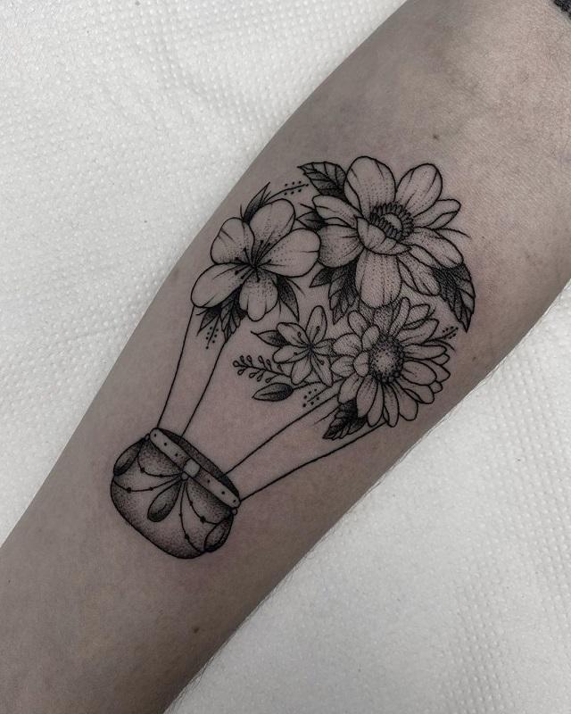 Tatuaje Angi Oliva globo de flores